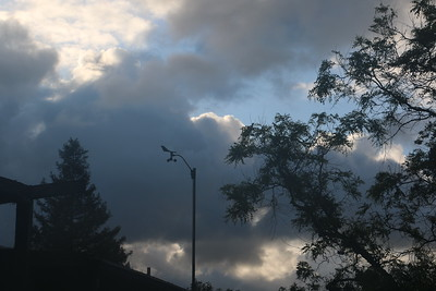 Storm clouds behind anemometer after dawn
