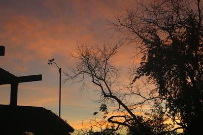 Cloud bands behind anemometer before dawn