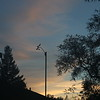 Thin clouds behind anemometer before dawn