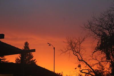 Red sky behind anemometer before dawn