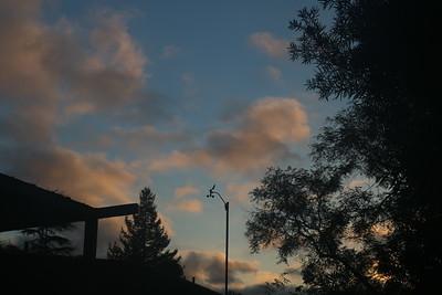 Broken clouds behind anemometer around dawn