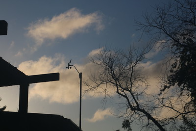 Streaming clouds behind anemometer after dawn