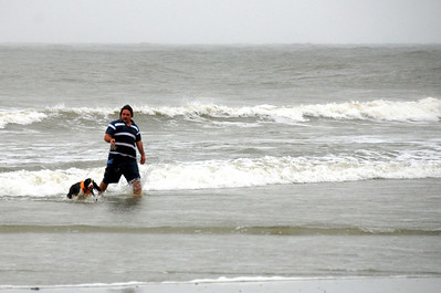Although it was raining this man was letting his dog go out swimming without letting go of the leesh. I'm sure they both enjoyed it.