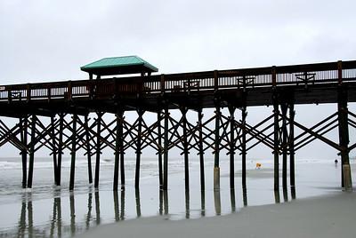 Folly Beach pier with beach treasure seekers