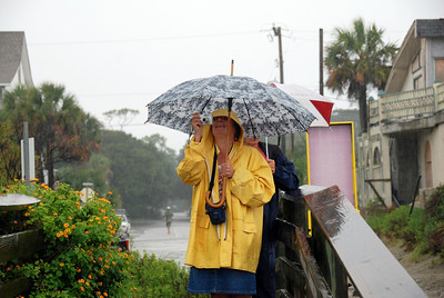 Andi, with her friend Nancy came out to make a picture of her first tropical storm. Hope to see you again when there is a hurricane Andi! :)