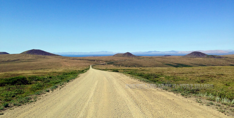 AK-SPt-2015.6.22#119.2. On the Teller road in the last hills before dropping down to sea level. Way in the distance are the first views of  Brooks Mountain on the other side of Port Clarence. Seward Peninsula Alaska.