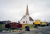AK-SPn,a-2001.6#1009.4. The Old Saint Joseph's Catholic Church. The oldest wood framed gothic building in Alaska. It was originally built in 1901 but fell in disrepair in the 1940's. The City of Nome moved it and rebuilt the 88 foot tall steeple in Anvil City Square and is now used as a Town Hall. Nome, Seward Peninsula Alaska.