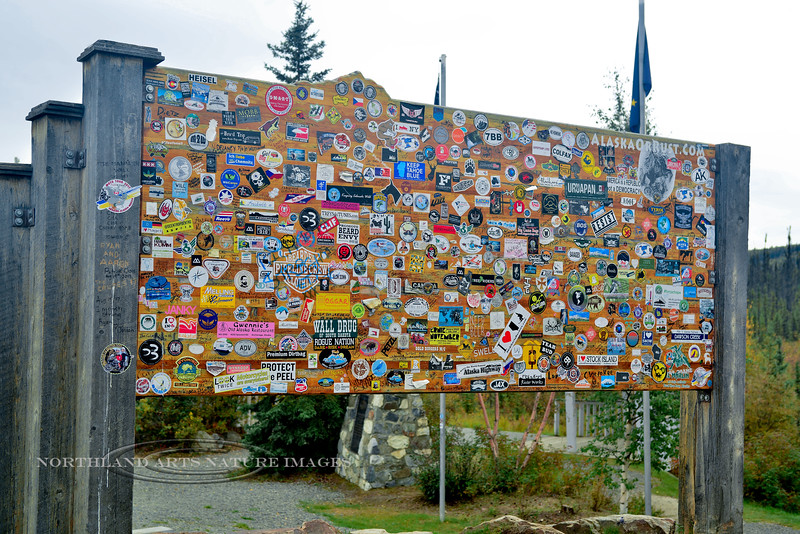 CANYK-2017.9.4#801.3. Sticker sign at the pull off where you leave Alaska and cross into the Yukon Territory Canada.