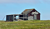 AK-SPns-2015.6.24#128.1. An abandoned camp along the Nome to Council road near the shore of Norton Sound. Seward Peninsula Alaska.