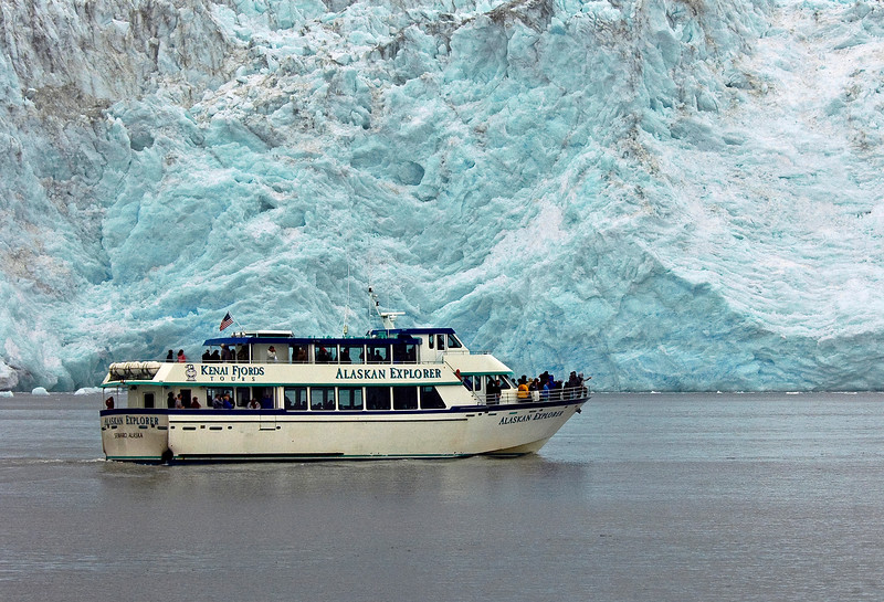 AK-2005.7.15#0160c2. The Kenai Fjords Alaskan Explorer in front of Holgate Glacier. Holgate flows from the Harding Ice field on the Kenai Peninsula into Aialik Bay Alaska. Photographed from another Kenai Fjords Vessel.