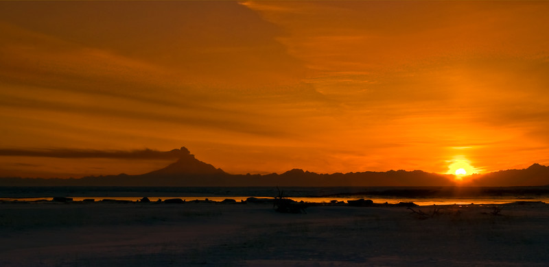 """AK-2009.4.4#134. """"Evening Eruption"""". A scene during the 2009 spring eruptions of Mount Redoubt Volcano.Viewed from near the Kenia small boat harbor on the east side of Cook Inlet Alaska."""