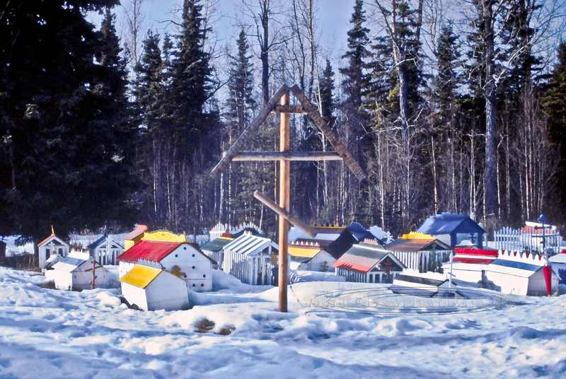 AK-E7-1984.3#00072.4. Russian Orthodox Cross and Athabaskan Spirit House. Saint Nicholas Russian Orthodox Cemetery, Eklutna Alaska.