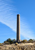AZ-2020.11.21#5231.2. The 129.5 foot tall Mayer Smokestack. A famous landmark in the Dewey-Mayer area near Prescott Valley Arizona. It was built when gold was discovered nearby in 1917. It was intended to be used for smelting mineral ore but never saw much use. View from State route 69.