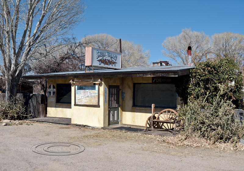 AZ-2021.3.1#5861.3. The Diner commemorating the Santa Fe RR  with a sign and Mural on the front wall. Skull Valley, Arizona.