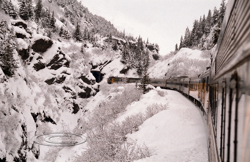 AK-1984.2#5.3. A view from the Alaska Railroad coming out of a tunnel in the Kenai Mountains. Heading for a day of Xcountry skiing at Grandview Alaska.