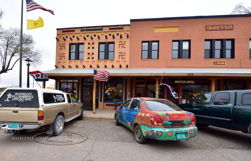 """NM-CPS1-2019.11.11#4323.1. The famous Shaffer Hotel built by Clem """"Pop"""" Shaffer. The symbols on the restaurant are not Swastika's. They are early American Indian symbols for Peace and Goodwill, especially with Navajo and Hopi people. The Navajo people called them """"Whirling Logs"""" Mountainair, New Mexico."""