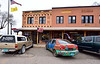 "NM-CPS1-2019.11.11#4323.1. The famous Shaffer Hotel built by Clem ""Pop"" Shaffer. The symbols on the restaurant are not Swastika's. They are early American Indian symbols for Peace and Goodwill, especially with Navajo and Hopi people. The Navajo people called them ""Whirling Logs"" Mountainair, New Mexico."