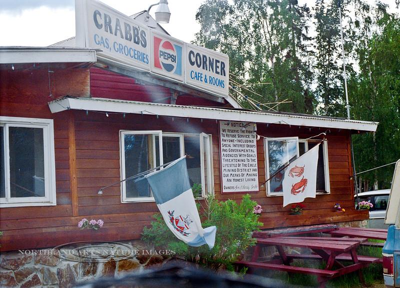 AK-Shw2000.6.21#10.2. Crabb's Corner, Central, Alaska. Read the warning on the sign.