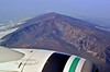 """HI-2015.2.8#394.4. Cinder Cones inside the ancient caldera near the summit of Moana Kea. The controversial Telescope installation is behind the caldera on the summit ridge. On the """"Big Island"""" of Hawai'i. Viewed from an Alaska Airlines Jet."""