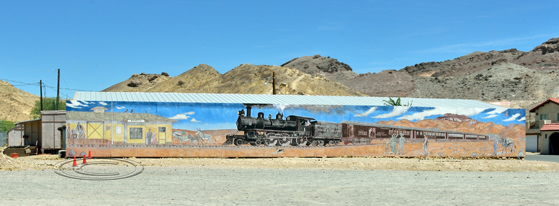 """NV-2021.6.14#7211.2. A depiction of a Train from the """"Old Days"""" arriving in Beatty Nevada."""