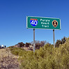 AZ-2021.2.21#5459.2. Take pause when you pass these Purple Heart signs and remember what they stand for. Route 40 heading into Kingman Arizona.