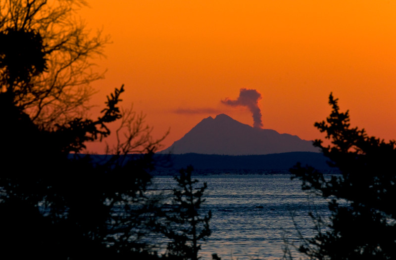 AK-2009.3.15#028.2. A sunset view from Beluga Point on Turnagain Arm of an eruption of Mount Redoubt across Cook Inlet Alaska.