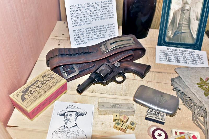 AZ-GFM-2018.10.8#019.2. A strange custom Gun belt & Colt revolver Buckskin Frank Leslie had made for quick draw. Gun Fighter's Museum, Tombstone Arizona.