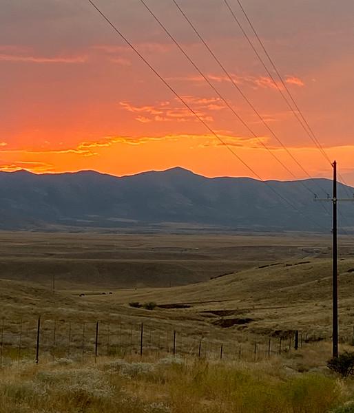 AZ-2020.8.22#0204.3. A beautiful sunrise over the prairie behind Prescott Valley Arizona looking towards the Black Hills. Photo by Mary Lou B.