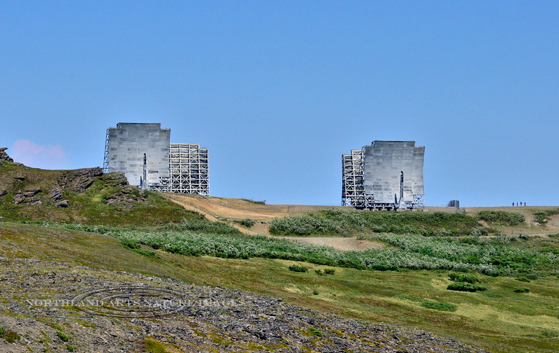 AK-SPa-2015.6.21#001.2. The White Alice Tropospheric Antennas on the top of Anvil Mountain Nome. It was built by the military for more accurate remote communications (WACs) in the early 1950's. It also served as a Distant Early Warning (DEW) line covering the Arctic Circle. It became obsolete with Satellite Communication. Seward Peninsula Alaska. Four people on the far right of the ridge give some perspective to the size. This is one of only a couple of White Alice sites that the Dept. of Defense didn't dismantle in the 1970's and 80's.