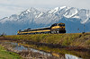 AK-2006.5.22#0229.4. An Alaska Railway passenger train passing Potter Marsh. Coming back from Seward Alaska with a back drop of the Kenai Mountains in Alaska behind them. Potter Marsh is just south of Anchorage Alaska.