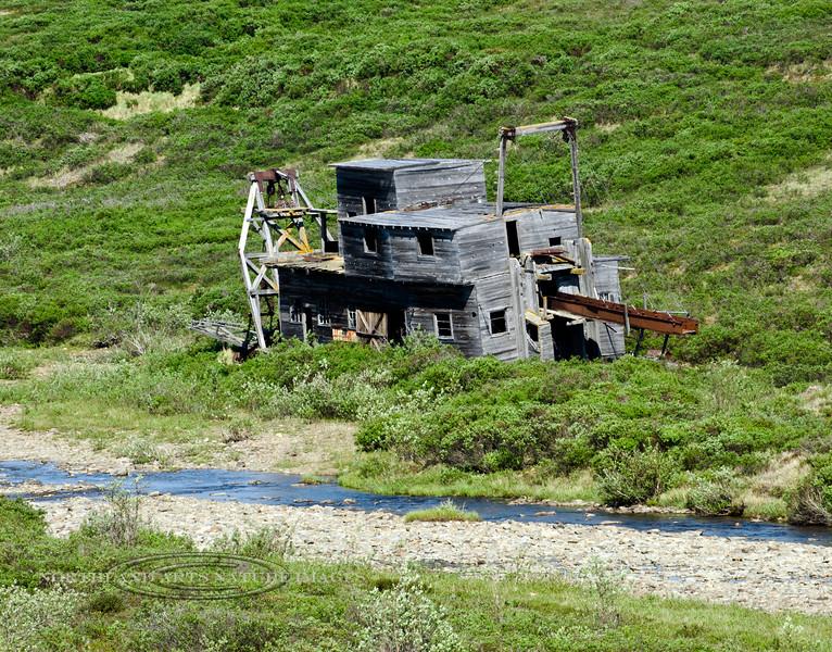 AK-SPt-2015.6.22#024.3. The Gold Run Dredge. M 53.7 of the Nome to Teller Highway. Seward Peninsula, Alaska.