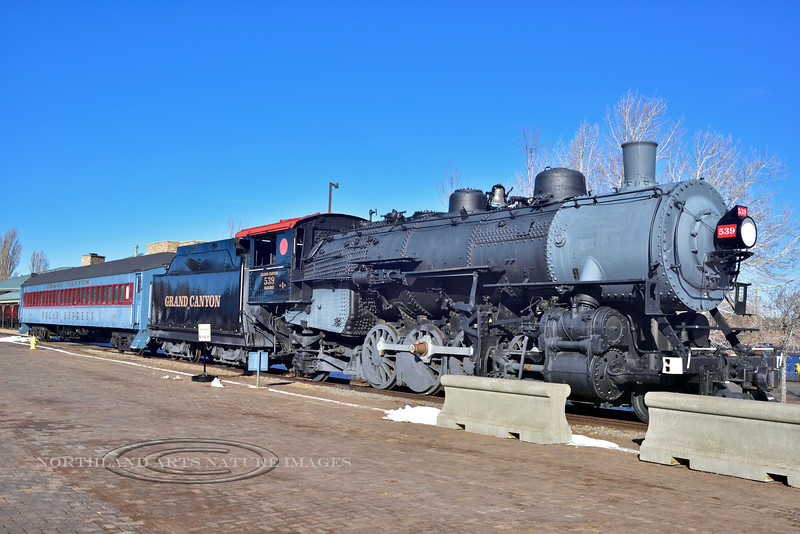 AZ-W-2018.3.1#060.2. The Grand Canyon SP & S 539 Steam Locomotive  with a Tender and a Polar Express car. This engine was built in 1919 in Dunkirk, New York. It was built for the N.P. and the Spokane, Portland & Seattle Railway who had incorporated with the Great Northern and Northern Pacific. They ran this Engine until 1957 where it went on display in several different Parks in Washington State. Grand Canyon Railway acquired it in 2007, rebuilt it and is now on display in Williams Arizona.