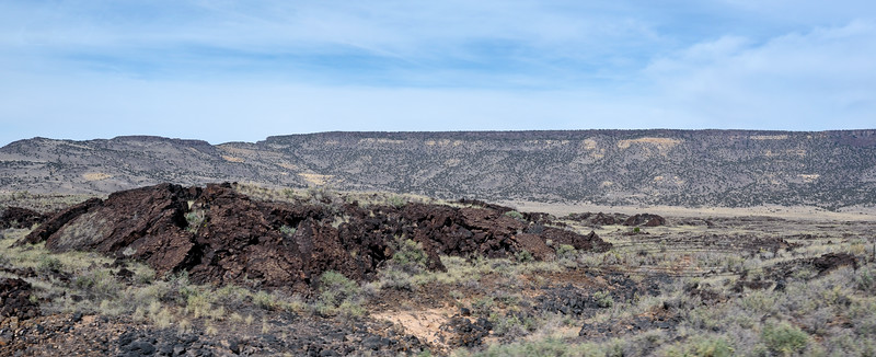 NM-2020.10.2#4485.4. Basaltic lava flows from the 23 million year old Miocene Epoch to the present Holocene. The reddish color is from the lava oxidizing with iron as it cooled. East of Grants New Mexico.
