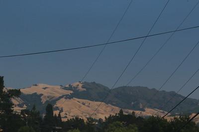 Distant hillside through the smoke