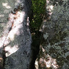 I am standing with one foot on each side of a crevice that has a long drop below me.<br /> Lost Overlook <br /> Brady Mtn CT TN
