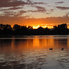 Sunset over Smith Lake in Washington Park, Denver, Colorado.