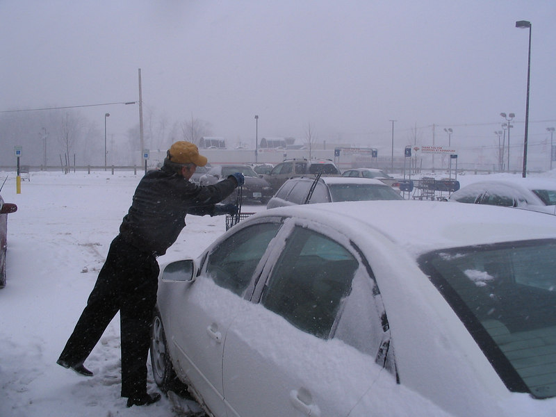 Ahhh...the joys of clearing snow and scraping ice.  Some genius at the rental-car company decided to put water in the windshield-wiper fluid, which meant the sprayers froze.  John (Royston's sales director) cleans the wipers and tries to get us ready to head to the airport.
