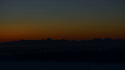 This taken on December 26, 2013, from the West Ridge of the University of Alaska Fairbanks.  The snow blowing off the Alaska Range, in particular Mt. Hayes, is back-lit by the rising sun early on.  Notice the changing shape of the silhouetted range early in the sequence.  This is an effect of the strong inversion frequently present in the Tanana Valley.  After the Sun comes up the wind direction above the inversion changes and the flow from the Fairbanks power plants goes out into the valley, obscuring the range.