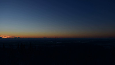 Sunrise (10:50AM) to sunset (2:40PM)  from the Parks Overlook about 15 miles southwest of Fairbanks on December 16, 2013.  Mt. Moffit, 13,020, is on the extreme left and Denali, 20,320, is on the extreme right.  It was about -20 where the camera and me were, about -30 on the flats.  While there were few clouds this day, there was a fair amount of haze and smoke from Fairbanks drifting down the Tanana River.  D800E, 24-70 f/2.8 zoom, a frame every 10 seconds.  Power came from a deep cycle RV battery with an AC inverter into which the Nikon AC adapter for the D800E was plugged.