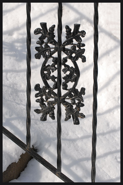 Snow and iron railing detail, at nearby park.