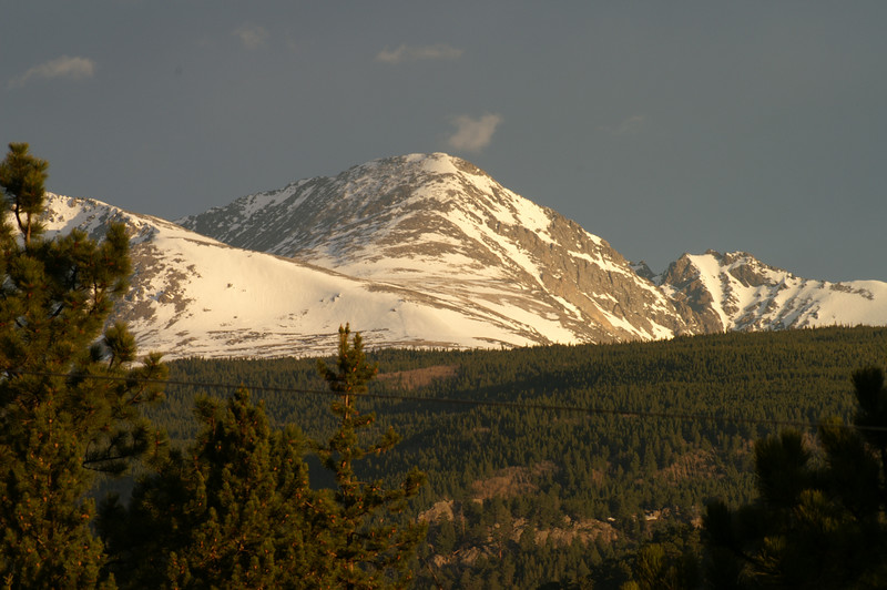 The snow is melting off the mountain ridges