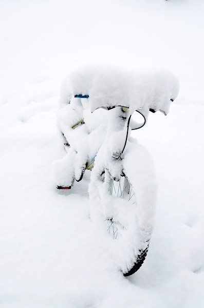 Bicycle Under Fluff Snow