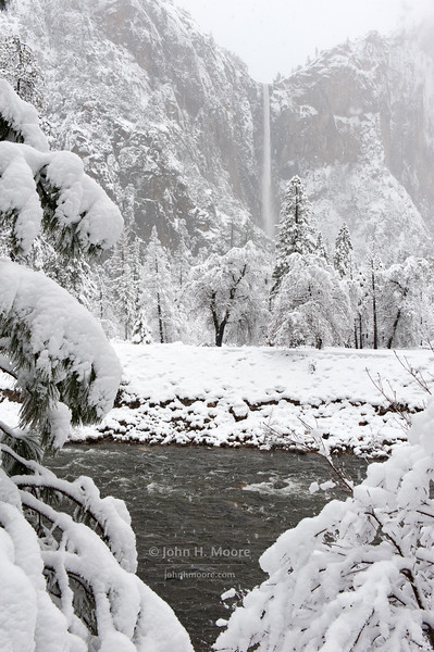 Bridalveil Falls during a heavy winter snowstorm.  Yosemite National Park.