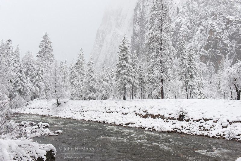 The Merced River in Yosemie National Park during a heavy winter snowstorm.