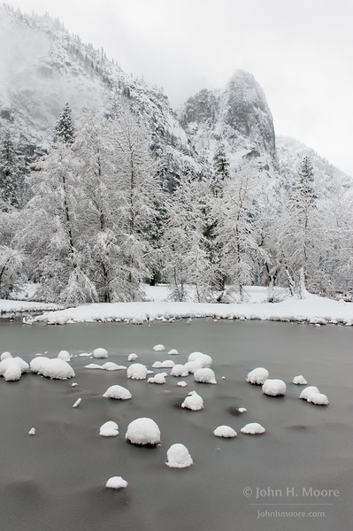 Sentinel Rock overlloks icy flooded wetlands in Cook's Meadow, Yosemite National Park.