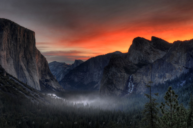 Winter sunrise in Yosemite Valley with frozen Bridalveil Falls on the right