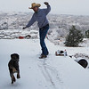 My brother trying to ski on our porch with his dog, Diesel, chasing him.  I like to snow.  :)