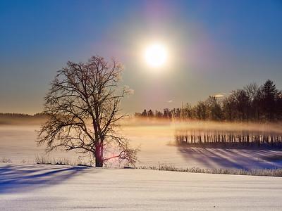 Morning sun over frozen lake