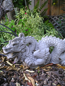 Snake-dragon deity was hard to get a photo of, hiding as he was behind a lemon-tree-branch prop and a gladiolus.
