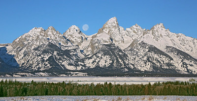 3 mornings after the full moon, the waning moon sets 3 hours later than when it did at it's full phase. That is when you can capture some morning shots with a nice size moon in the western sky. We got out into the Grand Tetons NP and caught it just before it dropped  below the mountain peaks.